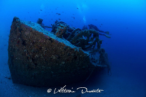 Wreck and divers by Vittorio Durante